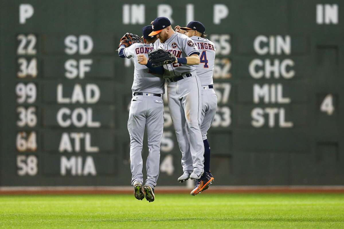 BOSTON, MA - SEPTEMBER 29: George Springer #4, Marwin Gonzalez #9 and Derek Fisher #21 of the Houston Astros celebrate after a victory over the Boston Red Sox at Fenway Park on September 29, 2017 in Boston, Massachusetts. (Photo by Adam Glanzman/Getty Images)