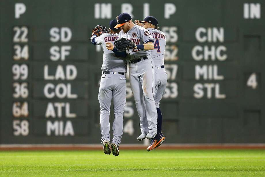 BOSTON, MA - SEPTEMBER 29:  George Springer #4, Marwin Gonzalez #9 and Derek Fisher #21 of the Houston Astros celebrate after a victory over the Boston Red Sox at Fenway Park on September 29, 2017 in Boston, Massachusetts.  (Photo by Adam Glanzman/Getty Images) Photo: Adam Glanzman/Getty Images