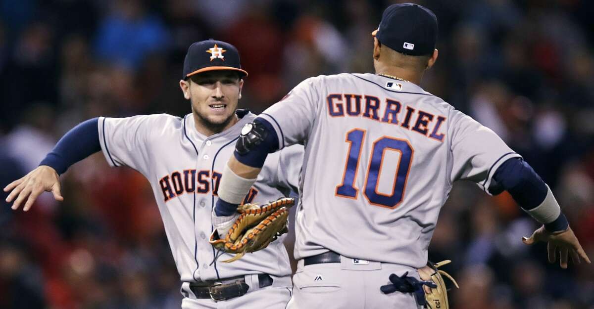 Houston Astros' Alex Bregman, left, and Yuli Gurriel (10) celebrate after the Astros defeated the Boston Red Sox 3-2 in a baseball game at Fenway Park in Boston, Friday, Sept. 29, 2017. Bregman drove in three runs. (AP Photo/Charles Krupa)
