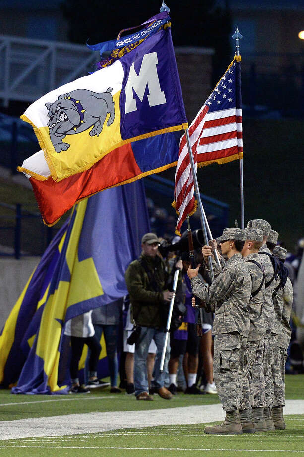Midland High ROTC color guard members present flags before the start of the game against Lee Sept. 29, 2017, at Grande Communications Stadium. James Durbin/Reporter-Telegram Photo: James Durbin