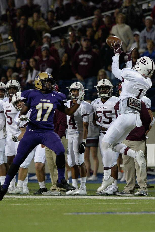 Lee's Sheldon Bass (1) makes a catch in front of Midland High's Josh Acrey (17) Sept. 29, 2017, at Grande Communications Stadium. James Durbin/Reporter-Telegram Photo: James Durbin