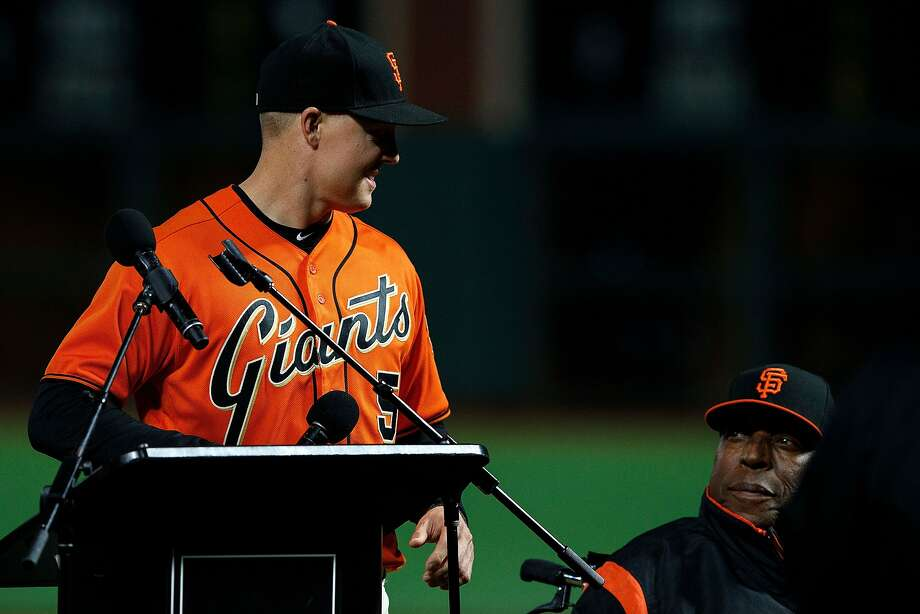 SAN FRANCISCO, CA - SEPTEMBER 29: Nick Hundley #5 of the San Francisco Giants is presented with the 2017 Willie Mac Award by Hall of Fame first baseman Willie McCovey before the game against the San Diego Padres at AT&T Park on September 29, 2017 in San Francisco, California. (Photo by Jason O. Watson/Getty Images) Photo: Jason O. Watson, Getty Images