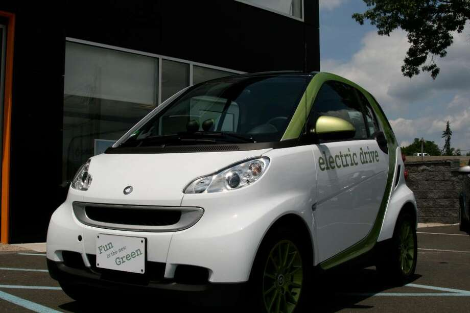 Newly designed smart fortwo electric drive runs entirely on electric energy. smart center Fairfield has been picked along with 4 other dealerships nationwide to lease a limited quantity this October, prior to the car's 2012 mass production. Photo: Contributed Photo, Paul Hoffman / Fairfield Citizen