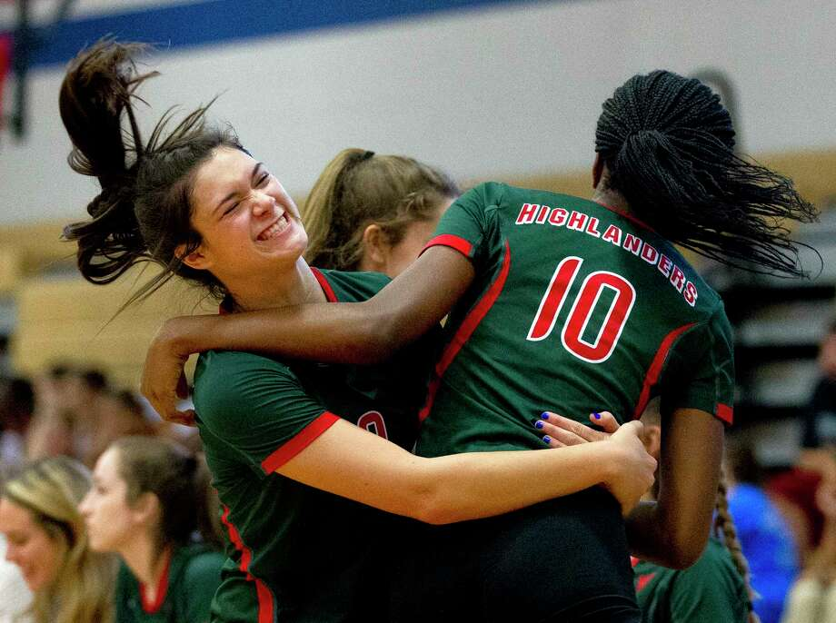 The Woodlands' Amanda Ifeanyi, right, celebrates with Dylan Maberry after blocking a shot during the first set of a District 12-6A high school volleyball match at Oak Ridge High School, Friday, Sept. 22, 2017. Photo: Jason Fochtman, Staff Photographer / © 2017 Houston Chronicle