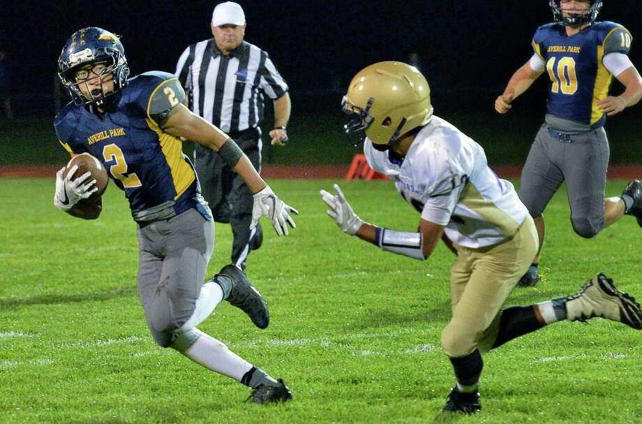 Averill Park's #2 Garrett Wagner, left, gets away from  Amsterdam defender #18 Deanthony Colon during Friday night's game Sept. 29, 2017 in Averill Park, NY.  (John Carl D'Annibale / Times Union) Photo: John Carl D'Annibale / 40041663A