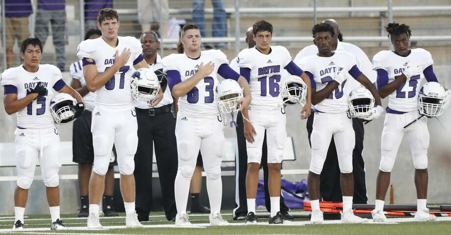 Dayton players during the National Anthem before the start of the first half of a high school fiootball game at Texan Drive Stadium,  Friday, Sept. 29, 2017, in Porter.   ( Karen Warren / Houston Chronicle ) Photo: Karen Warren/Houston Chronicle