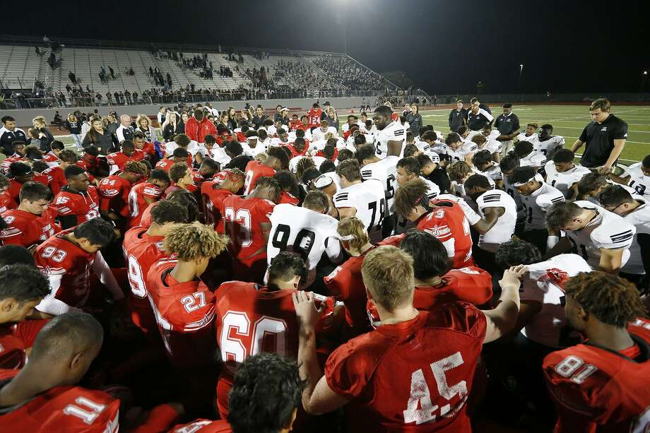 Members of the Judson Rockets and Steele Knights pray after their game Friday Sept. 29, 2017 at Rutledge Stadium. Judson won 35-28. Photo: Edward A. Ornelas, Staff / San Antonio Express-News / © 2017 San Antonio Express-News