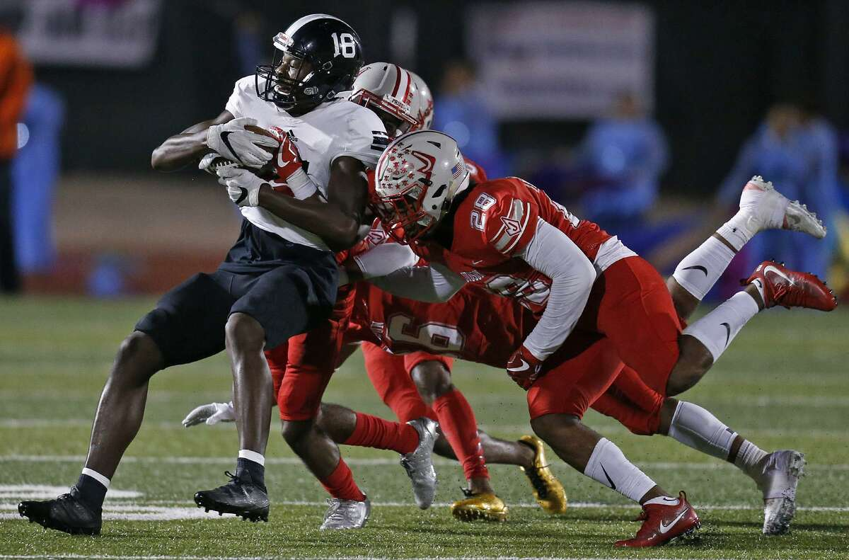 Steele's Daniel Jackson is gang tackled by Judson defenders during first half action Friday Sept. 29, 2017 at Rutledge Stadium.