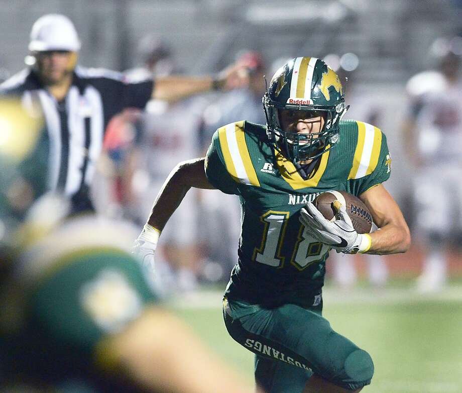 Nixon running back Emil Olivia and the Mustangs dominated Sharyland 49-14 on Friday night. Photo: Cuate Santos /Laredo Morning Times File / Laredo Morning Times