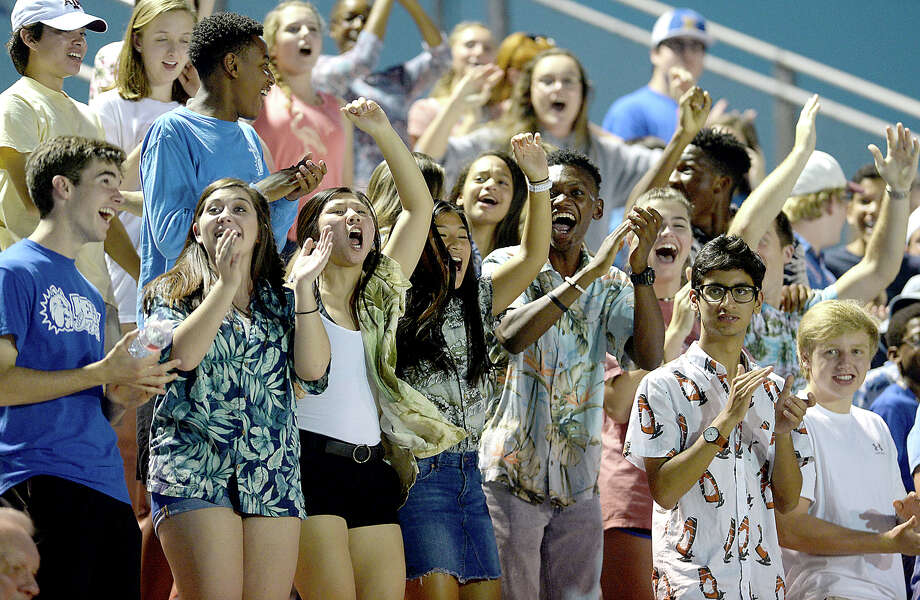 Kelly's fans go wild as the Bulldogs quickly convert the kick-off return into a touchdown against Orangefield Friday night at Monsignor Kelly Held High School. Photo taken Friday, September 29, 2017 Kim Brent/The Enterprise Photo: Kim Brent / BEN