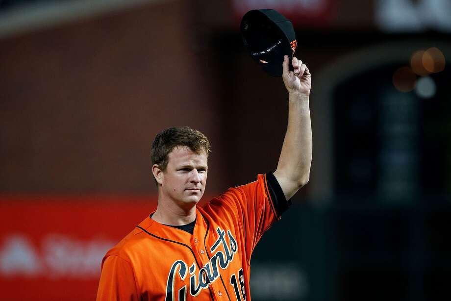 Giants pitcher Matt Cain tips his cap during a pre-game ceremony Friday. Cain will make his last career start Saturday. Photo: Jason O. Watson, Getty Images