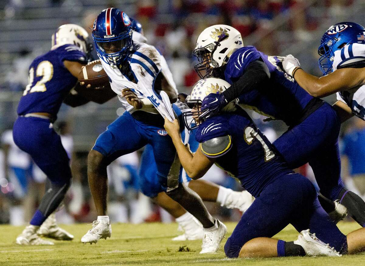 Montgomery defensive tackle Keaton Bussell (28) drags down Beaumont West Brook running back James Jones (5) during the third quarter of a District 12-6A high school football game at Bear Stadium, Friday, Sept. 29, 2017, in Montgomery.