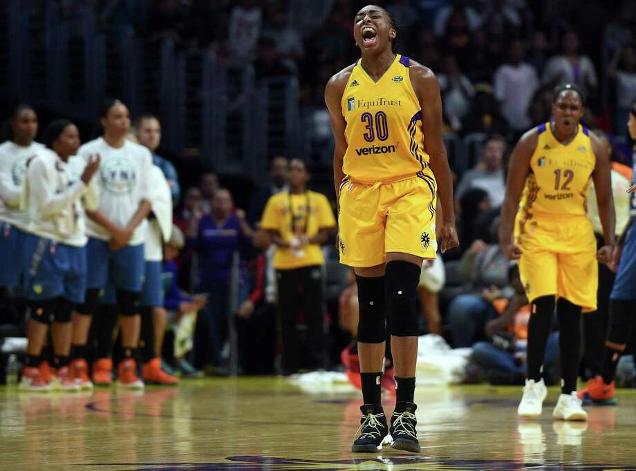 LOS ANGELES, CA - SEPTEMBER 29: Nneka Ogwumike #30 of the Los Angeles Sparks celebrates after forcing a turnover against Minnesota Lynx during the second half of Game Three of WNBA Finals at Staples Center September 29, 2017, in Los Angeles, California. NOTE TO USER: User expressly acknowledges and agrees that, by downloading and/or using this photograph, user is consenting to the terms and conditions of the Getty Images License Agreement. (Photo by Kevork Djansezian/Getty Images) Photo: Kevork Djansezian / Getty Images / 2017 Getty Images