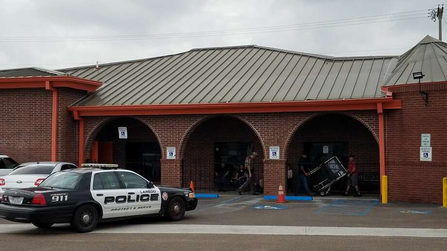 Authorities raid a business in north Laredo, located near the corner of McPherson Road and Fenwick Drive, on the afternoon of Friday, Sept. 29. Photo: Cesar Rodriguez/Laredo Morning Times