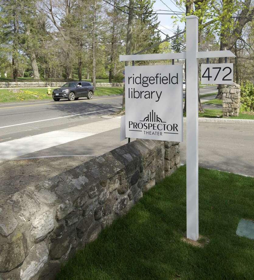 The new and improved Ridgefield Library will have its re-opening this weekend, May 9-11. The original 1903 building of the Ridgefield, Conn, library has been incorporated into a new 44,000 square foot library. Wednesday, May 7, 2014. Photo: H John Voorhees III / H John Voorhees III / The News-Times Freelance