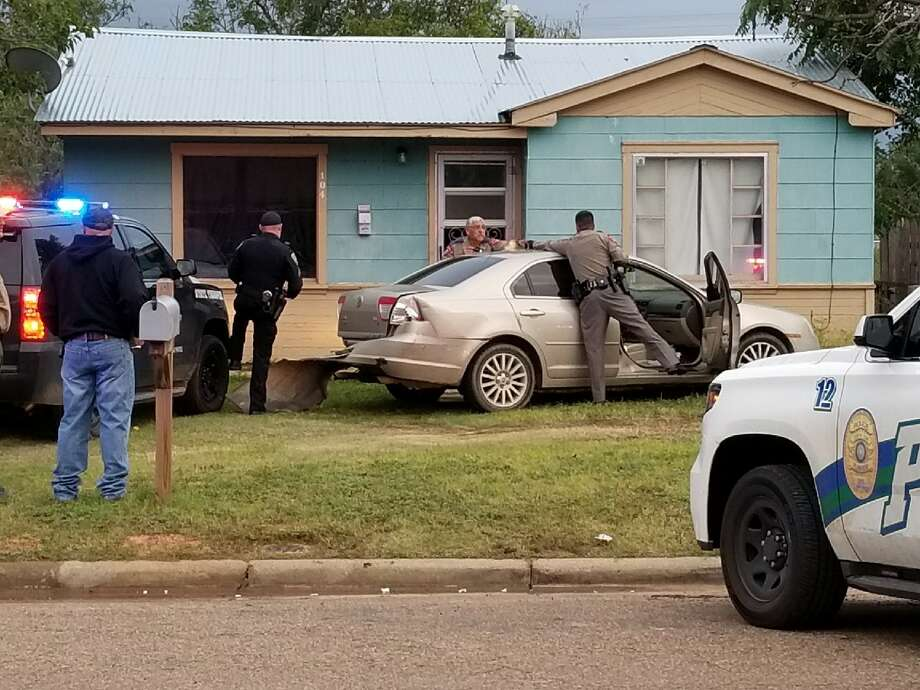 Texas Department of Public Safety troopers and Plainview police officers inspect a vehicle that ended up in the front yard of 104 Oak St. following a lengthy pursuit that began about 6:40 p.m. Friday outside Hale Center. At least nine emergency vehicles from four departments were involved in the pursuit that lasted almost 15 minutes before the suspect was taking into custody on multiple charges.