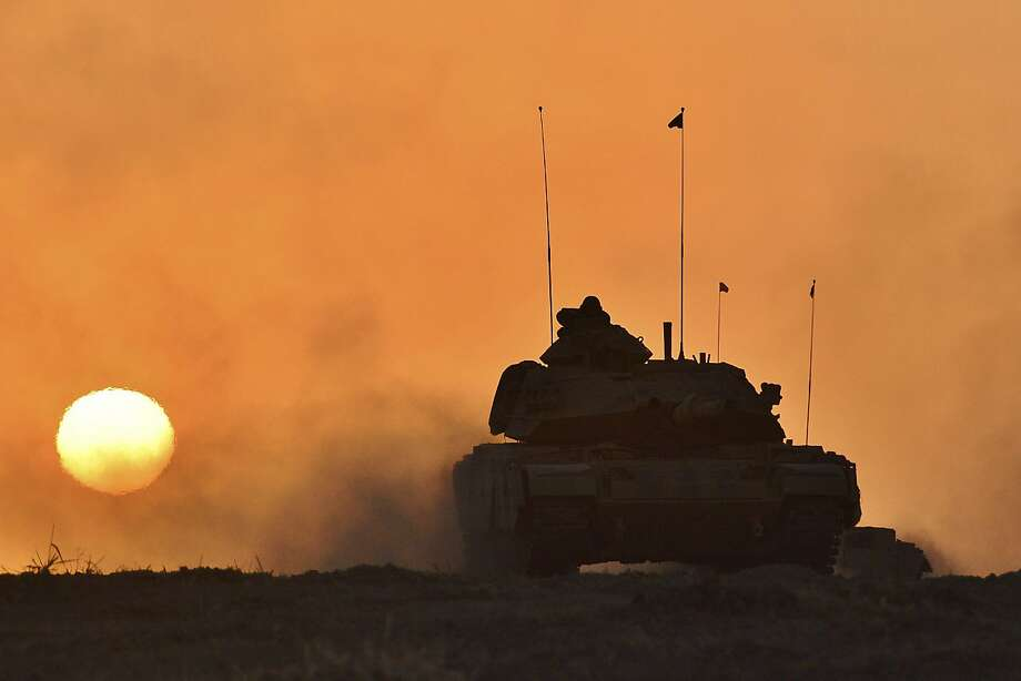 In this photo taken Friday, Sept. 29, 2017, a Turkish army tank moves, in Silopi, near the Habur border gate with Iraq, southeastern Turkey. Tanks with Turkish and Iraqi soldiers holding the Turkish and Iraqi flags rolled on a field as the two countries' militaries conducted joint exercises on Turkey's border with Iraq's semi-autonomous Kurdish region. (Pool photo via AP ) Photo: Associated Press