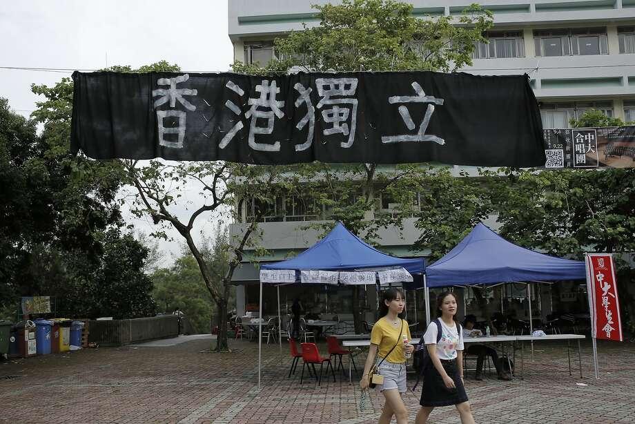 "Students walk beneath a banner last month proclaiming ""Hong Kong Independence"" at the Chinese University of Hong Kong campus in Hong Kong. Photo: Kin Cheung, Associated Press"