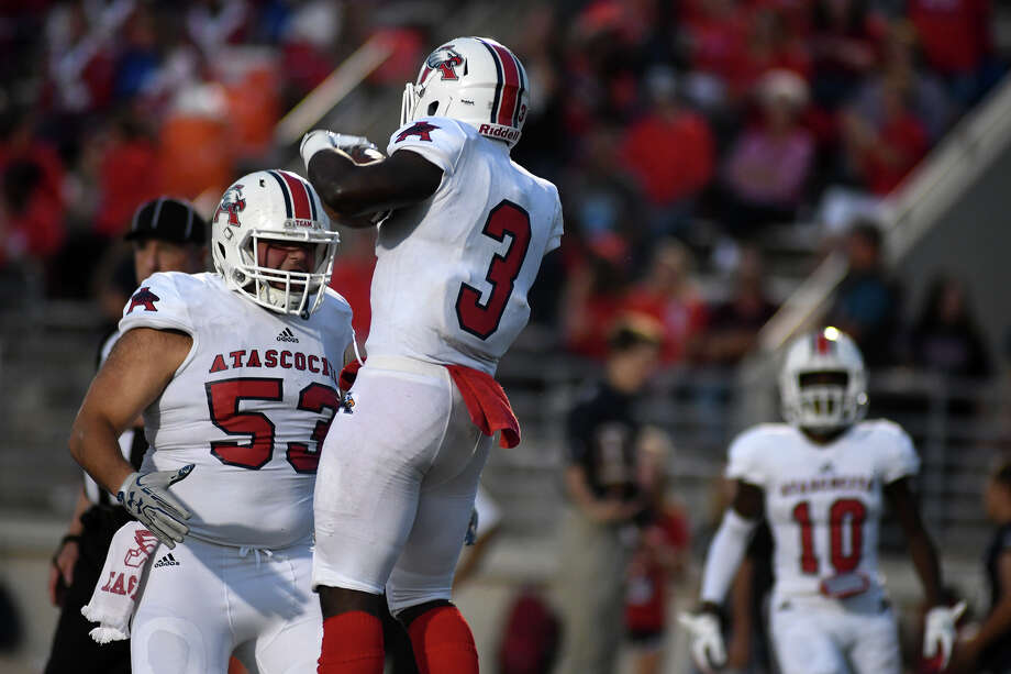 Atascocita senior offensive lineman Justin Guajardo (53) celebrates teammate Decarlos Demmerritte's touchdown run against Kingwood after the senior running back scored during the first quarter of their district opener at Turner Stadium in Humble on Sept. 29, 2017. (Photo by Jerry Baker/Freelance) Photo: Jerry Baker, Freelance / Freelance
