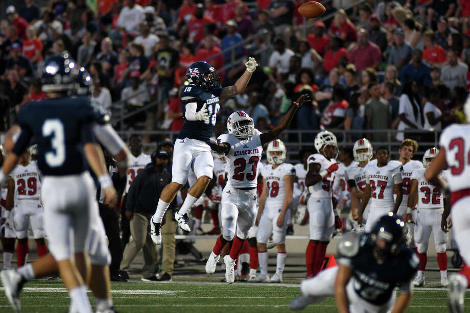 Kingwood junior tailback Carter Amarantos (18) attempts to finish a catch against Atascocita senior defensive back Aaron Durham (23) during the first quarter of their district opener at Turner Stadium in Humble on Sept. 29, 2017. (Photo by Jerry Baker/Freelance) Photo: Jerry Baker, Freelance / Freelance