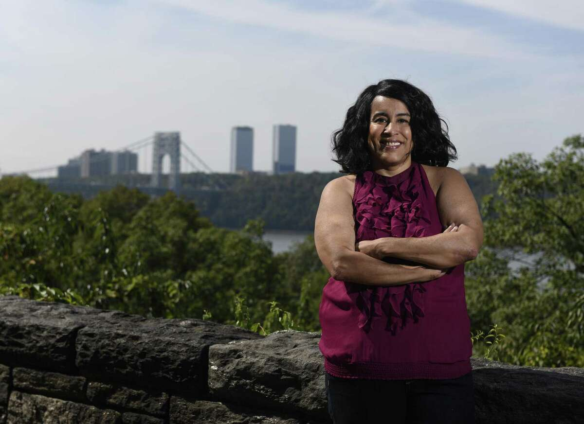 Teresa Vega poses near her apartment in the Inwood neighborhood of New York, N.Y. Tuesday, Sept. 26, 2017. Vega researched her family members, descended from slaves, who farmed in an area around Round Hill Road in Greenwich referred to as Hangroot.