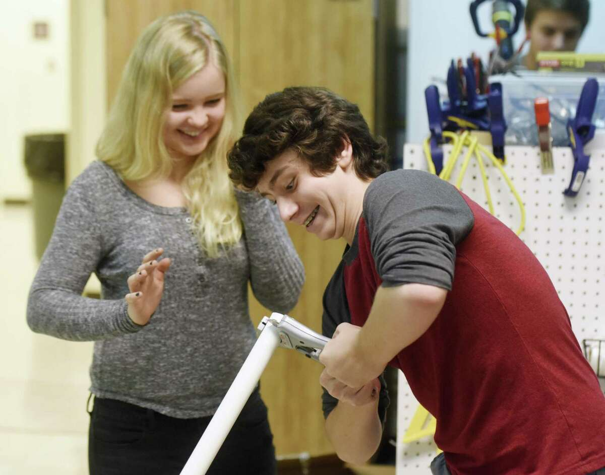 Junior Ben Wolff cuts a PVC pipe for a project as Sophie Anderlind watches during an Innovation Lab class at Greenwich High School in Greenwich, Conn. Thursday, Sept. 28, 2017. The STEM-focused Innovation Lab has expanded for the 2017-2018 school year by adding a grade, creating a new classroom and adding several new teachers.