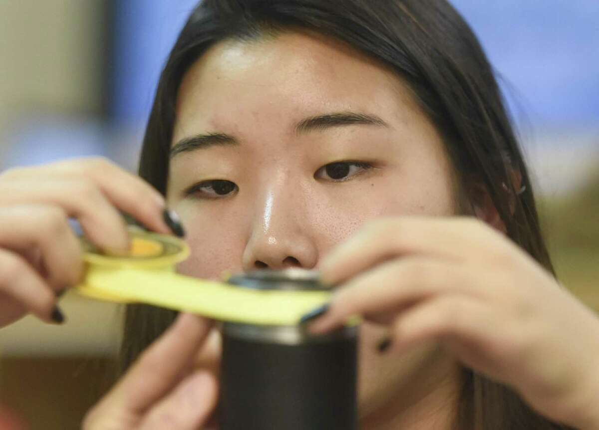 Junior Nina Hirai works on an air cannon project during an Innovation Lab class at Greenwich High School in Greenwich, Conn. Thursday, Sept. 28, 2017. The STEM-focused Innovation Lab has expanded for the 2017-2018 school year by adding a grade, creating a new classroom and adding several new teachers.