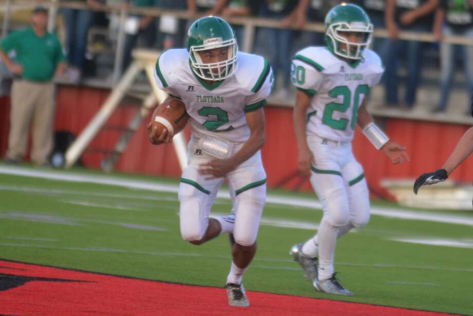 Floydada running back Rosendo Reyna, 2, rushes for yardage as teammate Marcus Perez, 20, looks on in the background during a game earlier this season. Reyna ran for 209 yards and three touchdowns and Perez rushed for a score in a victory over Lubbock Roosevelt Friday night. Photo: Skip Leon/Plainview Herald
