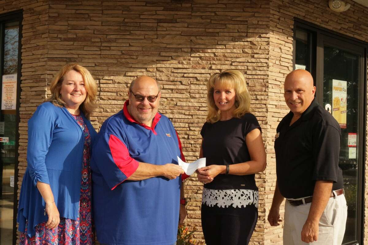 Gene Nachamkin and Joe DiCarlo of Sonic Drive-Ins present officials from the Epilepsy Foundation of Northeastern New York with $10,200 check from their Lemonade for Livy campaign. The summer-long fund raising effort was the first of its kind in the Capital Region and raised money and awareness for the foundation through selling paper lemons and donating a portion of drink sales.