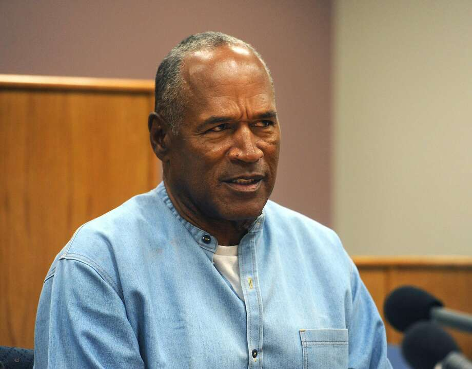 """(FILES) This file photo taken on July 20, 2017 shows O.J. Simpson during his parole hearing at the Lovelock Correctional Center in Lovelock, Nevada. Disgraced American football star O.J. Simpson, whose racially charged 1995 murder trial riveted the nation, is expected to be released from prison as early as October 2,, 2017 after nine years behind bars for armed robbery. Simpson, 70, plans to relocate to Florida following his release from the Lovelock Correctional Center, the medium-security prison in Nevada where he has been serving his sentence, said his lawyer, Malcolm LaVergne.  / AFP PHOTO / POOL / Jason Bean / RESTRICTED TO EDITORIAL USE - MANDATORY CREDIT """"AFP PHOTO /POOL/Reno Gazette-Journal/ Jason Bean"""" - NO MARKETING NO ADVERTISING CAMPAIGNS - DISTRIBUTED AS A SERVICE TO CLIENTS  JASON BEAN/AFP/Getty Images Photo: JASON BEAN, AFP/Getty Images"""