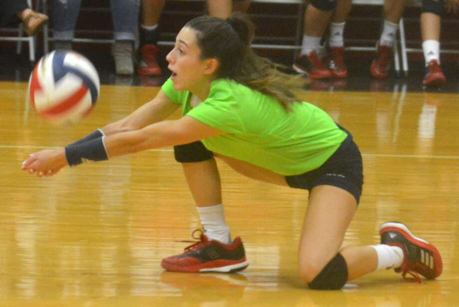 Plainview libero Julissa Chavez goes to a knee to return a shot during a match earlier this season. Chavez had 15 digs in a three-set loss at Canyon Saturday. Photo: Skip Leon/Plainview Herald