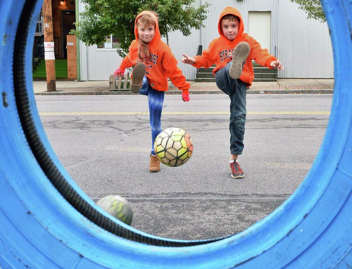 Twins Eli, left, and Eliot Merritt of East Greenbush take a soccer challenge during the 9th Annual OKTOBERFEST Block Party Saturday Sept. 30, 2017 in Albany, NY. (John Carl D'Annibale / Times Union)