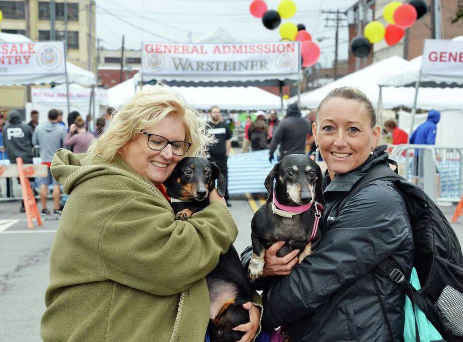 Kathy Giuliano, left, and daughter-in-law Melanie Giuliano with dachshunds Snoopy and Jasmine at the 9th Annual OKTOBERFEST Block Party Saturday Sept. 30, 2017 in Albany, NY.  (John Carl D'Annibale / Times Union) Photo: John Carl D'Annibale / 20041470A