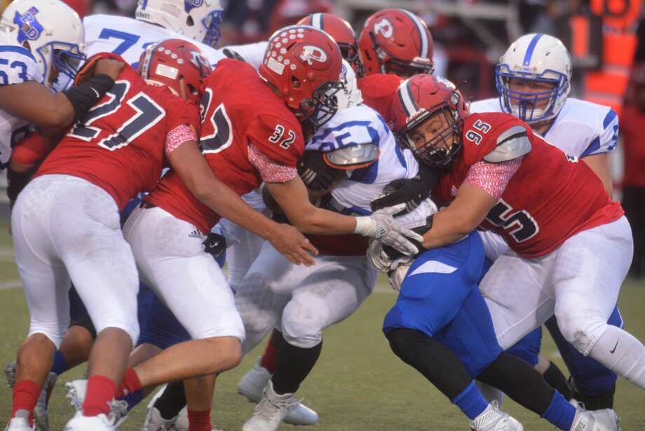 Plainview defenders Charles Gipson (95), Aidan Garcia (32) and Jesus Flores-Rios (27) team up to stop Palo Duro running back Tony Green during the opening District 3-5A football game at Greg Sherwood Memorial Bulldog Stadium Friday night. Photo: Skip Leon/Plainview Herald
