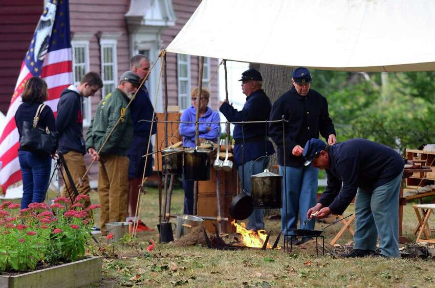 The Stratford Historical Society hosted a Civil War encampment featuring members of Company F of the 14th Connecticut Infantry Regiment in Stratford, Conn., on Saturday Sept. 30, 2017. Members of the original company served in several major battles during the Civil War including the Battle of Antietam in MD and the Battle of Gettysburg in PA. Today's encampment featured life during that era including authentic cooking, battlefield medicine, field drills and an open house at the historic society's museum and homestead.