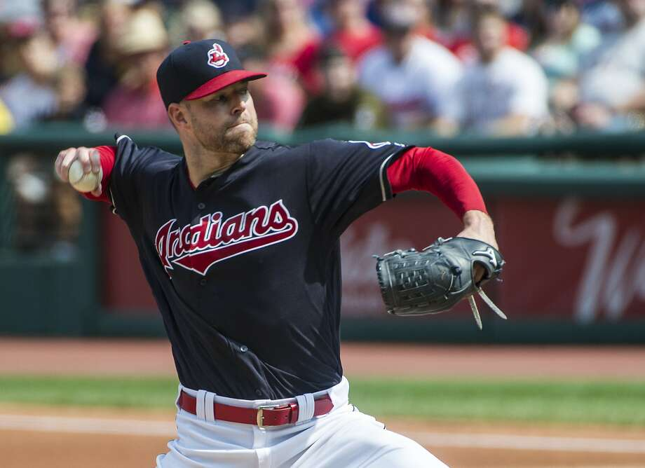 Cleveland Indians starting pitcher Corey Kluber delivers to Kansas City Royals' Melky Cabrera during the first inning of a baseball game in Cleveland, Sunday, Sept. 17, 2017. (AP Photo/Phil Long) Photo: Phil Long, Associated Press
