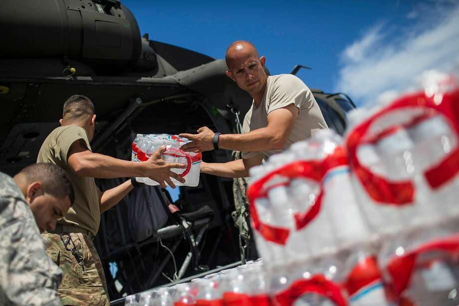 Army and National Guard troops load water and food into helicopters for delivery across Puerto Rico. Officials estimated about half the territory's residents didn't have access to clean water. Must credit: Photo by Dennis M. Rivera Pichardo for The Washington Post Photo: Dennis M. Rivera Pichardo, For The Washington Post