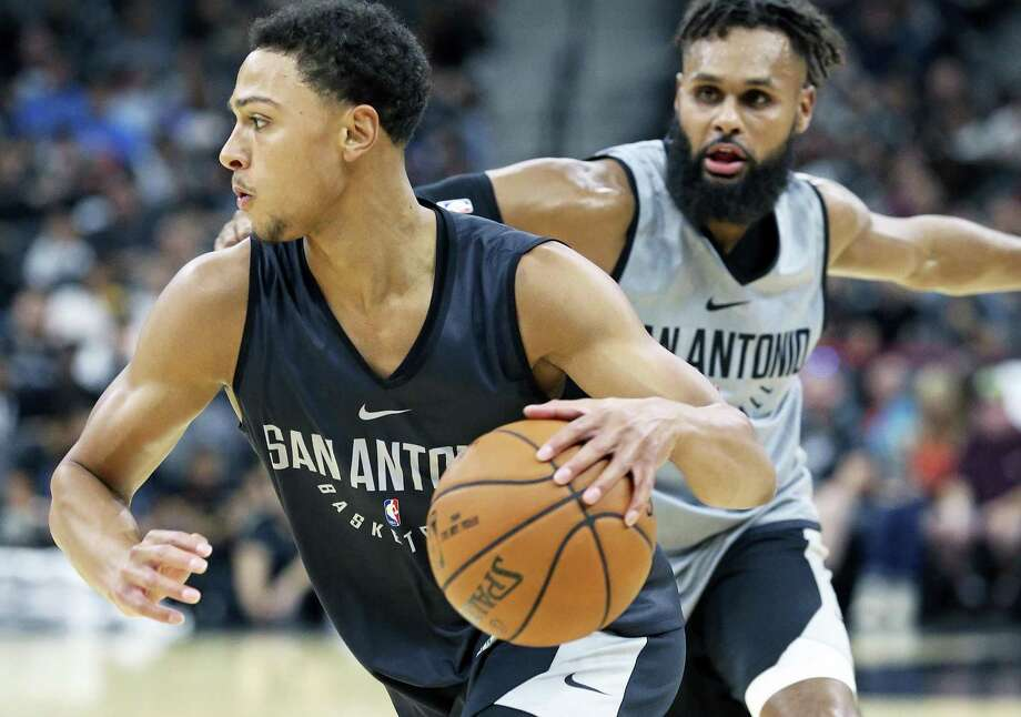 Bryn Forbes gets away from Patty Mills druing the Spurs' Silver & Black intrasquad scrimmage at the AT&T Center on Sept. 30, 2017. Photo: Tom Reel /San Antonio Express-News / 2017 SAN ANTONIO EXPRESS-NEWS