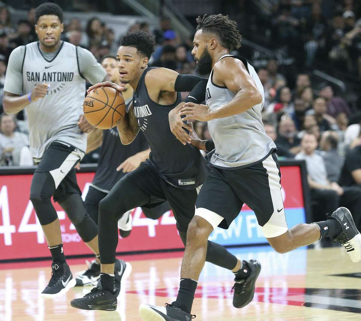 Dejounte Murray races down court during the Spurs' scrimmage at the AT&T Center on Sept. 30.