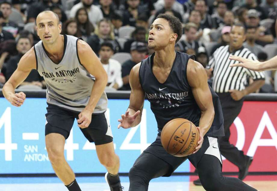 Bryn Forbes goes to the hoop, with Manu Ginobili watching, at the Spurs' Silver & Black intrasquad scrimmage at the AT&T Center on Sept. 30, 2017. Photo: Tom Reel /San Antonio Express-News / 2017 SAN ANTONIO EXPRESS-NEWS