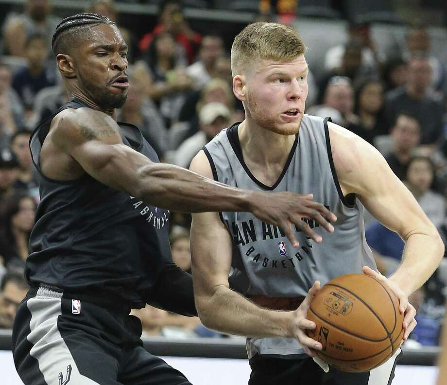 Davis Bertans (right) gets a rebound against Brandon Paul during the Spurs' Silver & Black intrasquad scrimmage at the AT&T Center on Sept. 30, 2017. Photo: Tom Reel /San Antonio Express-News / 2017 SAN ANTONIO EXPRESS-NEWS
