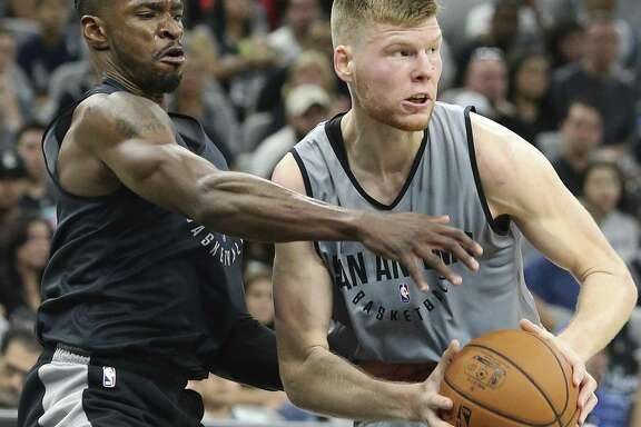 Davis Bertans (right) gets a rebound against Brandon Paul during the Spurs' Silver & Black intrasquad scrimmage at the AT&T Center on Sept. 30, 2017.