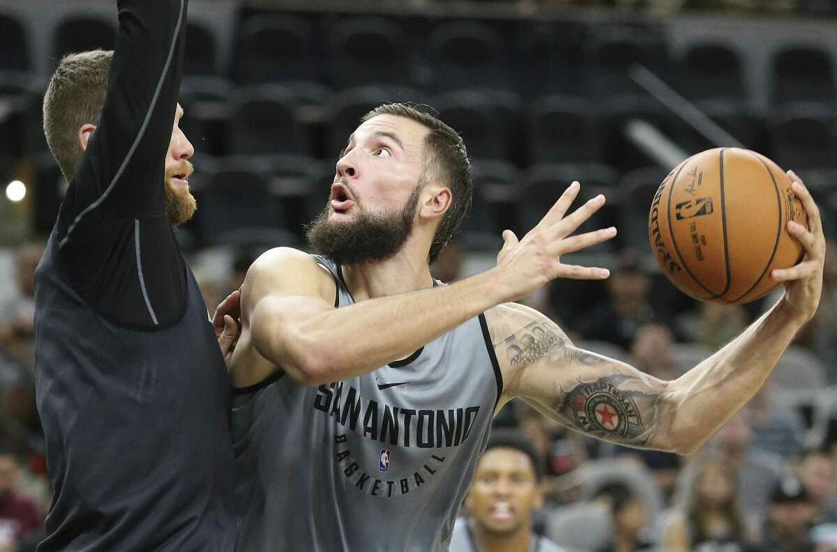 Joffrey Lauvergne puts up a shot over Matt Costello during the Spurs' Silver & Black intrasquad scrimmage at the AT&T Center on Sept. 30, 2017.