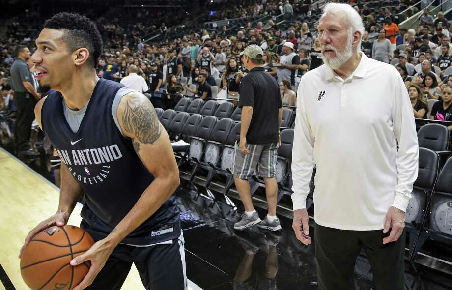 Coach Gregg Popovich tries to distract Danny Green while he warms before the Spurs' Silver & Black intrasquad scrimmage at the AT&T Center on Sept. 30, 2017. Photo: Tom Reel /San Antonio Express-News / 2017 SAN ANTONIO EXPRESS-NEWS
