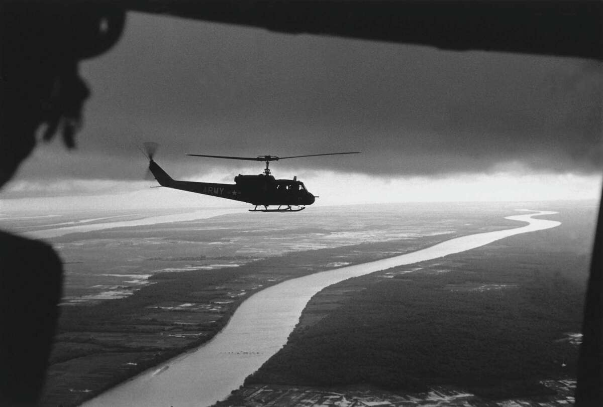 Top: South Vietnamese troops fly over the Mekong Delta in 1963.