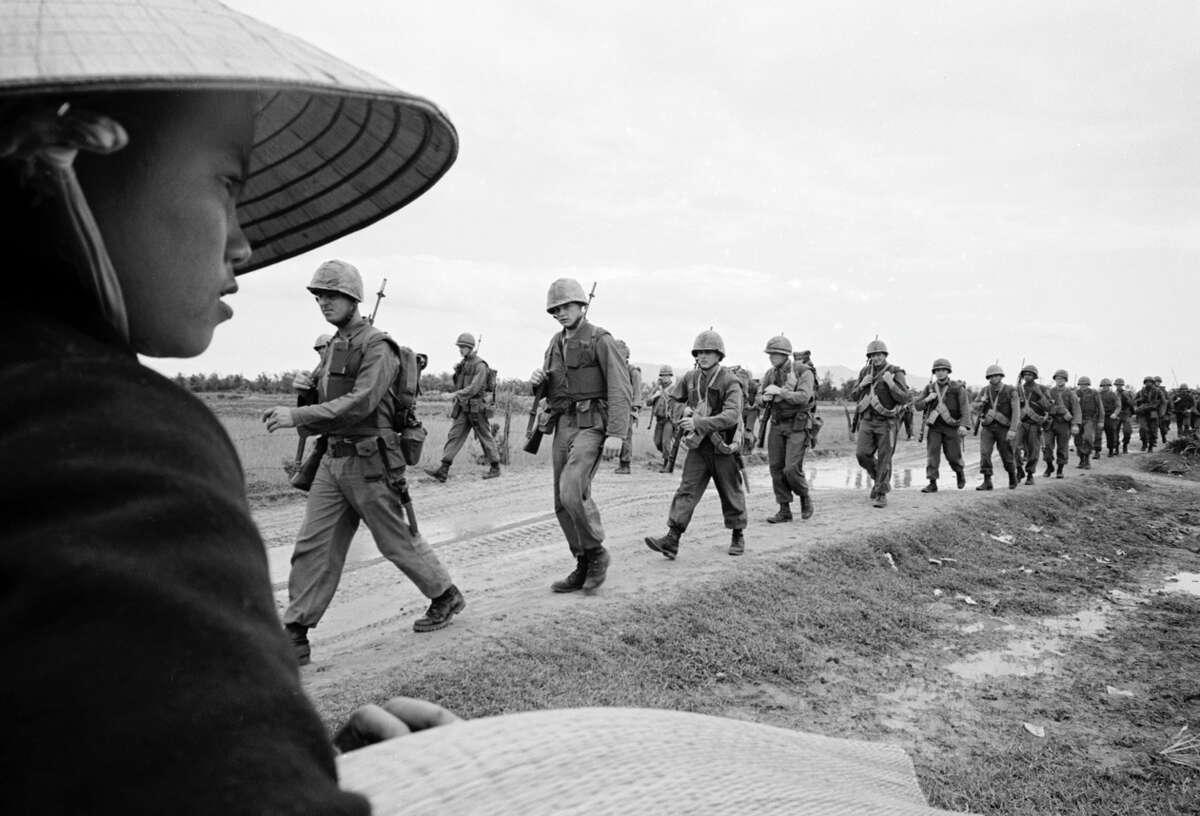 U.S. Marines march in Danang in 1965.