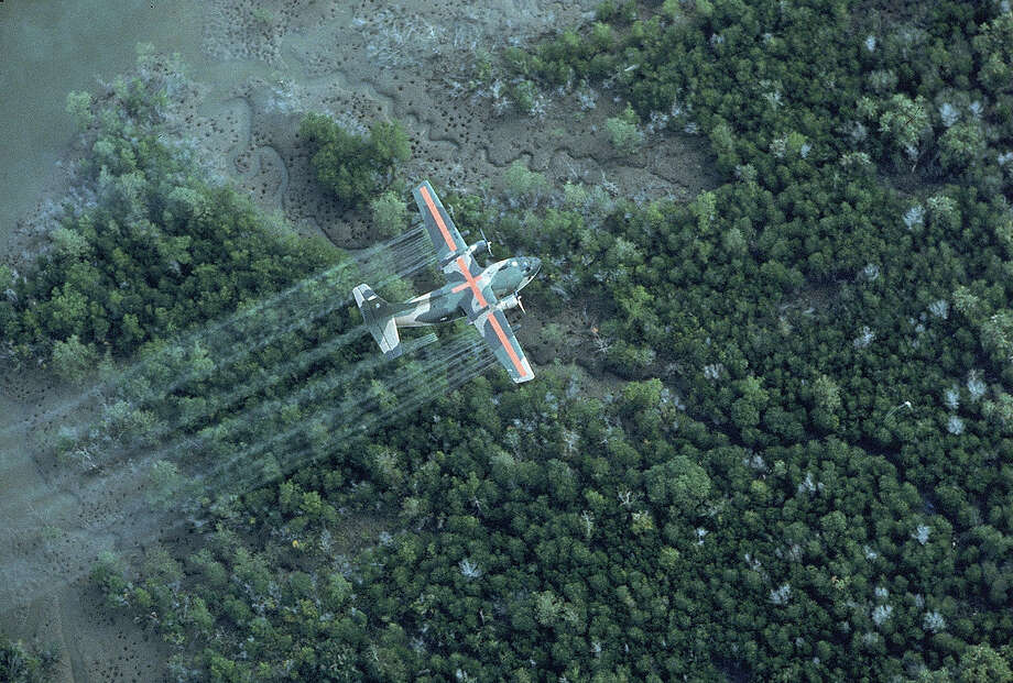 A U.S. Air Force plane sprays a delta area with Agent Orange during the height of the Vietnam War in 1970. Photo: Dick Swanson, Contributor / Dick Swanson