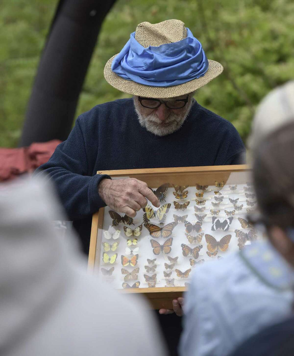 Lepidopterist Victor DeMasi shows volunteers working on the Norwalk River Valley Trail examples of butterflies that can be found in the area, Saturday morning in Ridgefield. September 30, 2017, in Ridgefield, Conn. The event was part of National Public Lands Day.