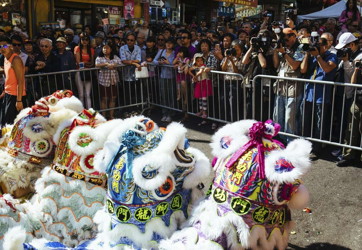 Crowds gather before the opening parade at the Autumn Moon Festival on San Francisco's Grant Avenue. The festival also included entertainment, moon cakes and souvenir vendors.