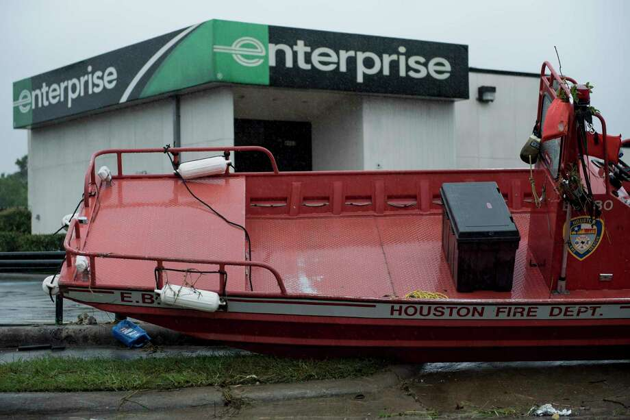 HOUSTON, TX - AUGUST 28:  Houston Fire Department Dive Team members motor through high water on North Braeswood Blvd looking for victims of the flooding from Hurricane Harvey August 28, 2017 in Houston, Texas. A Houston fire department rescue boat is seen stranded near a car rental shop during the aftermath of Hurricane Harvey on August 28, 2017 in Houston, Texas. Photo: BRENDAN SMIALOWSKI, Contributor / AFP or licensors